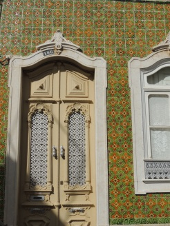Cream door with green tiles