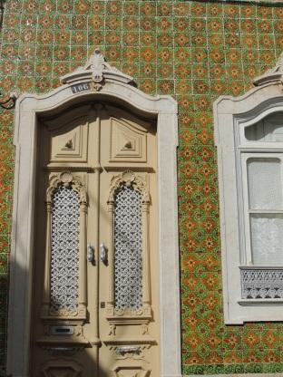 Cream door with green tiles
