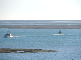 The navy returning and fisherman going out