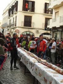 Cyclists prepare to distribute cake