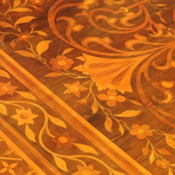 A close-up of the marquetry table