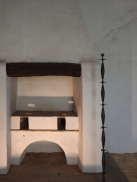 19th century oven with art installation beside