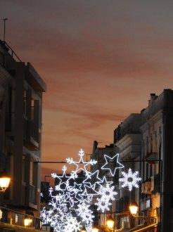 Christmas lights at sunset