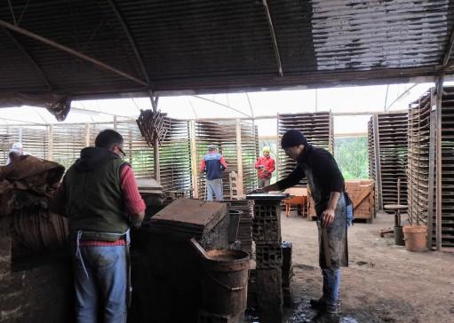 Tile moulder and bearer-off working in partnership