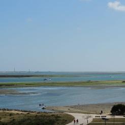 Low tide under a blue sky